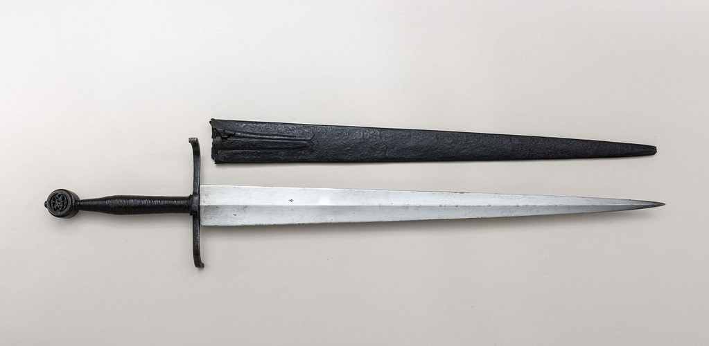 Photography of a surviving historical longsword with scabbard from ca 1450 - 75.The sword itself is probably from northern Italy, but this could have also been a German longsword.
